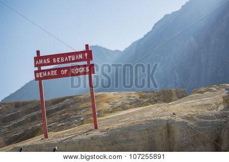 Beware of rocks sign at Kwah Ijen crater Java ,Indonesia.