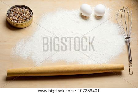baking background with flour and eggs. Top view.