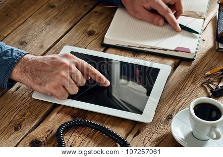 Man Clicks On The Blank Screen Tablet Computer