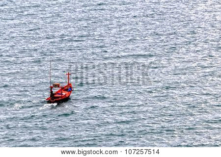 Fisherman Boat Sailing In The Sea
