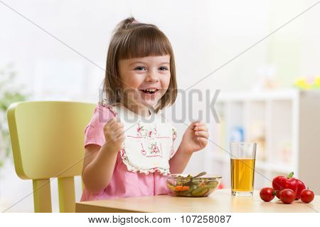 Toddler Sitting At Table Food Ready To Eat In The Nursery.