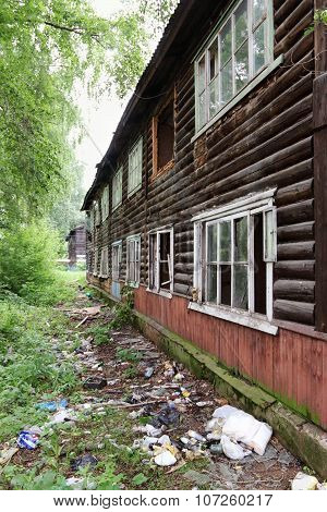 Old Wooden Two-story Abandoned Building With Garbage In Summer