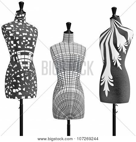 Patterned female mannequins in a black metal tripod, close view