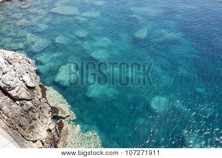 Sardinian Crystal Sea Seen From The Top With Rocks