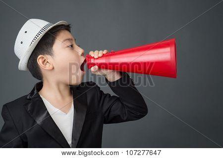 Little Asian Boy Using Megaphone Shouting