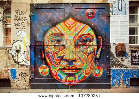 Graffiti With Beautiful Face Of Ethnic Lady On The Rustic Door