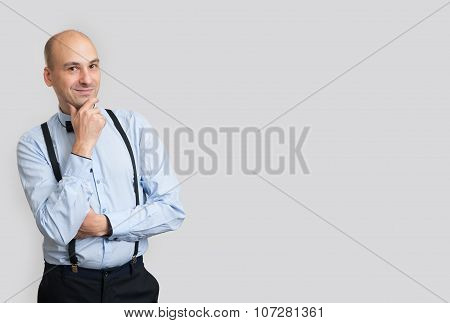 Bald Man Wearing Bow Tie And Suspenders