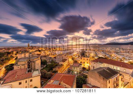 Sunset Over City Of Alghero On West Coast Of Sardinia