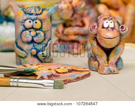Paintbrush clay panels and clay figurines of cats and monkeys