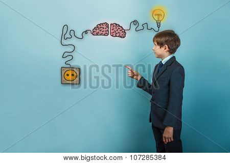 Teen boy businessman cancer is pointing at the charging cord plu