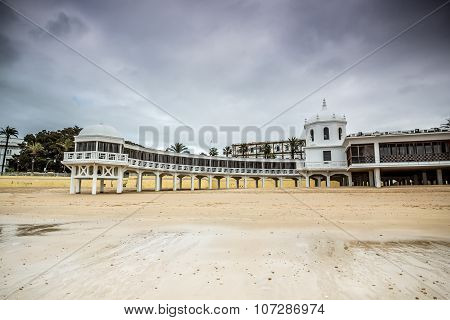 Old bathhouse on beach in Cadiz, Spain