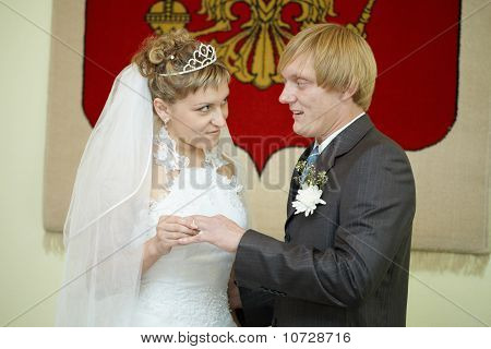 Young Bride Solemnly Ringed Groom