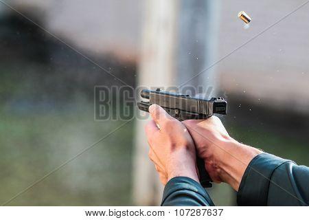 Pistol shot