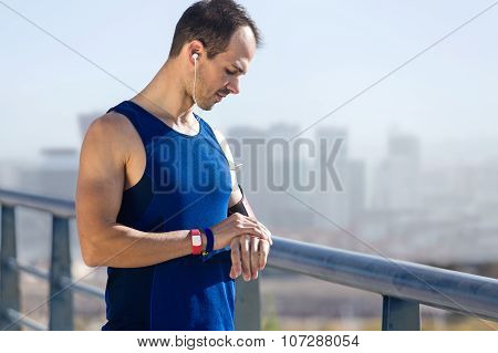 Runner Man Looking At His Pulse With Smartwatch.