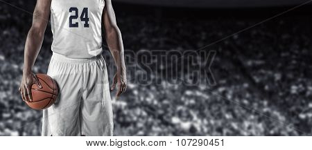 Close up view of Basketball Player in a large basketball arena. Wide angle photo with lots of copyspace.