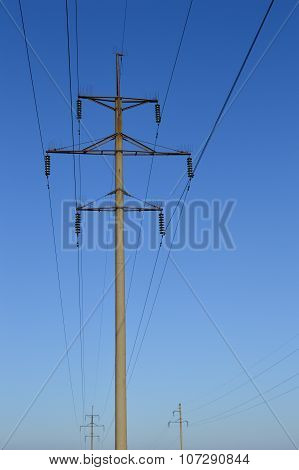 Power Linepower Lines On The Pole. Blue Sky