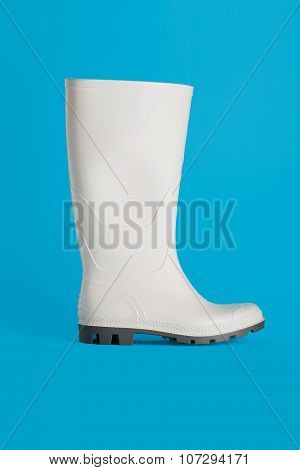 New White Rubber Boot Isolated On Blue Background