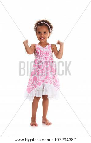 Full height smiling young girl with curly hair. Happy childhood