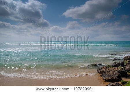 Waves, rocks and clouds