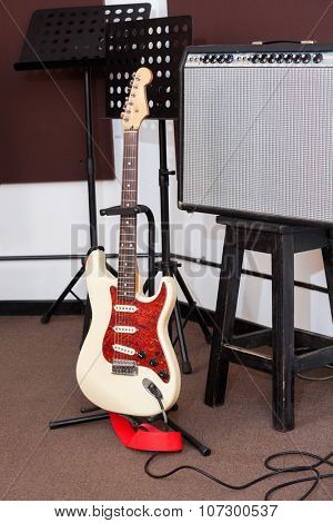 Electric guitar and tuner in recording studio
