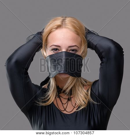 Woman with mask over her mouth