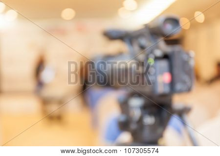 Abstract Blurred Background Of Video Camera Recording In Press Conference.