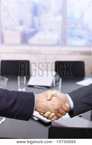 Businessmen Handshake Over Table