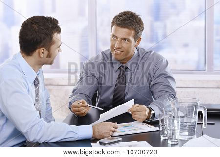 Businessmen Discussing Report