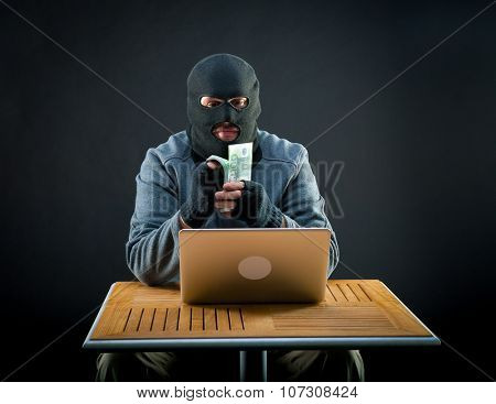 Cybercriminal man counts euro cash