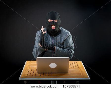 Cheerful hacker is ready to start hacking laptop