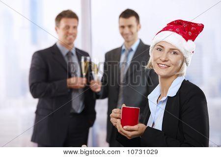 Businesswoman In Santa Claus Hat