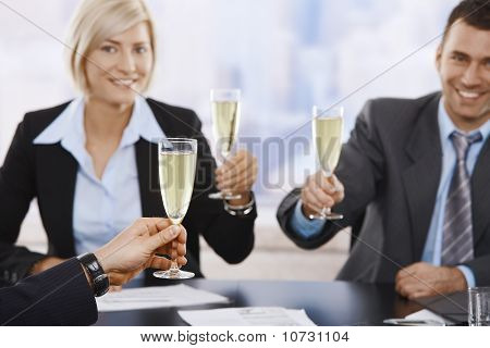 Business Executives Raising Toast With Champagne