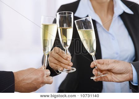 Business People Raising Toast With Champagne