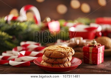 Christmas Candy Canes with Christmas decoration on table on bright background
