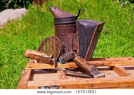 Old Smoker And Other Tools On The Wooden Box.