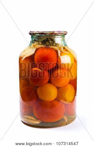 Glass Jar Of Canned Tomatoes On White Background.