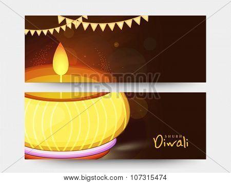 Shiny website header or banner set with illuminated oil lit lamp for Indian Festival of Lights, Happy Diwali celebration.
