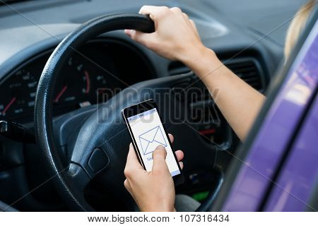 Hands Checking Message While Driving Car