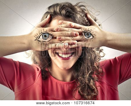 Blind girl with eyes painted on her hands