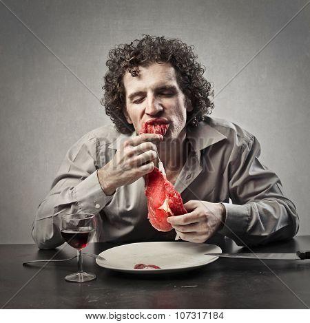 Disgusting man eating raw meat