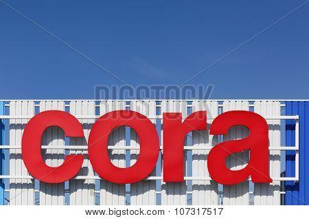 Cora sign on a facade