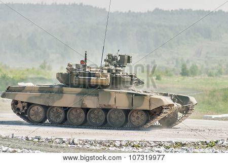 Tank T-80s in motion