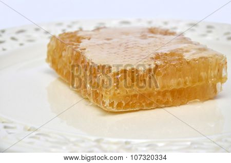 Picturesque Honeycomb On Porcelain Plate