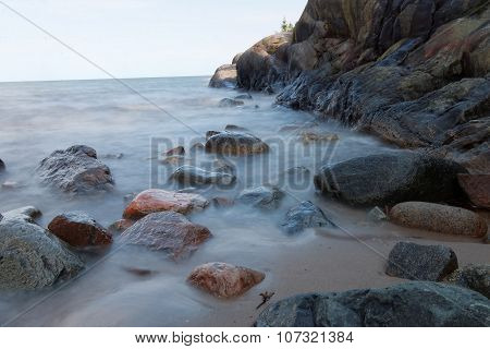 Rocks In The Milky Water