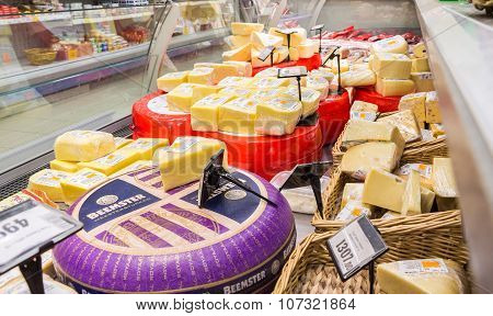 Showcase With Cheese Ready To Sale In Grocery Shop