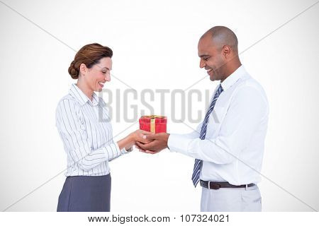 Business colleagues holding plant together against present