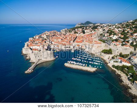 Aerial view of old city of Dubrovnik (Croatia) with old port in front. Dubrovnik is popular tourist attraction on Adriatic.