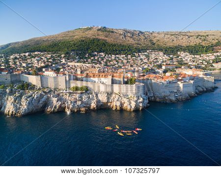 Aerial view of old city of Dubrovnik (Croatia), popular tourist attraction on Adriatic. Srdj mountain in the background.