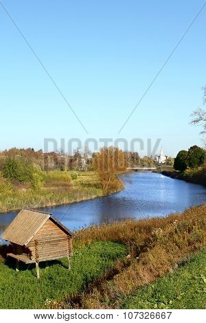 Russian Landscape With River Kamenka, barn on piles And Church