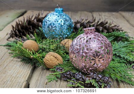 Blue And Pink Christmas Balls On Green Pine Needles